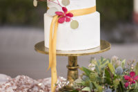 08 The wedding cake was a simple white one, with a mustard ribbon, greenery and a bloom