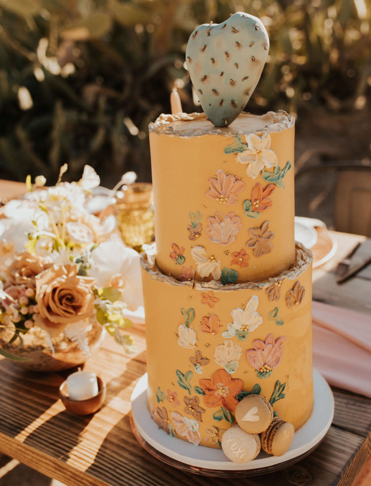 The wedding cake was a yellow one, with painted flowers and a cactus on top