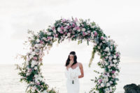 08 The wedding ceremony arch was a circle of blush, white blooms and fresh greenery