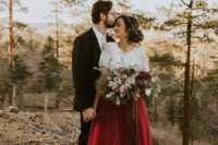 08 a chic bridal outfit with a white lace top and short sleeves plus a burgundy maxi skirt