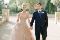 08 a strapless wedding ballgown with a whimsically draped skirt done in tan color looks unusual