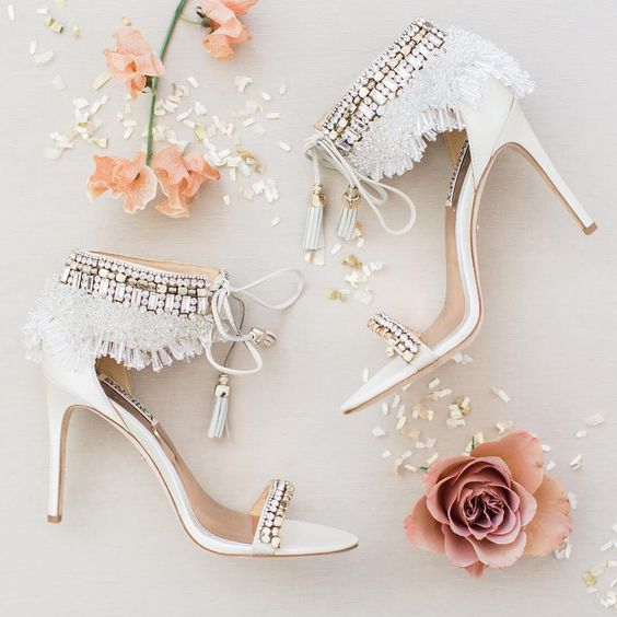 gorgeous white boho glam wedding heels with rhinestones, fringe and lace up tassels for a romantic yet free-spirited look