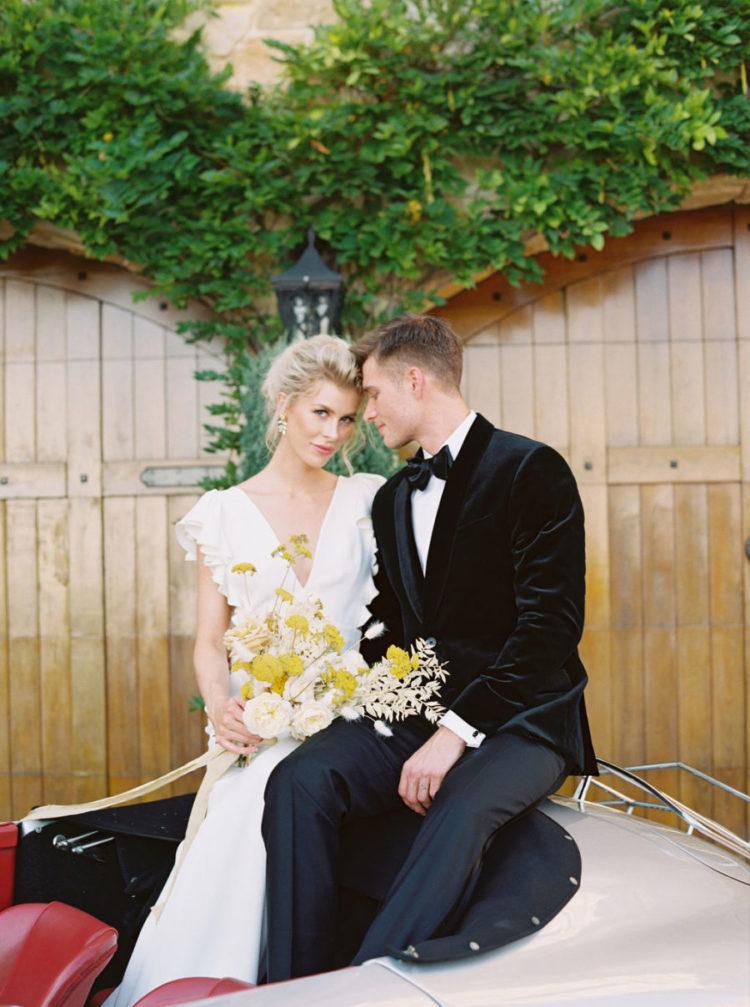 The groom was wearing a black velvet tuxedo
