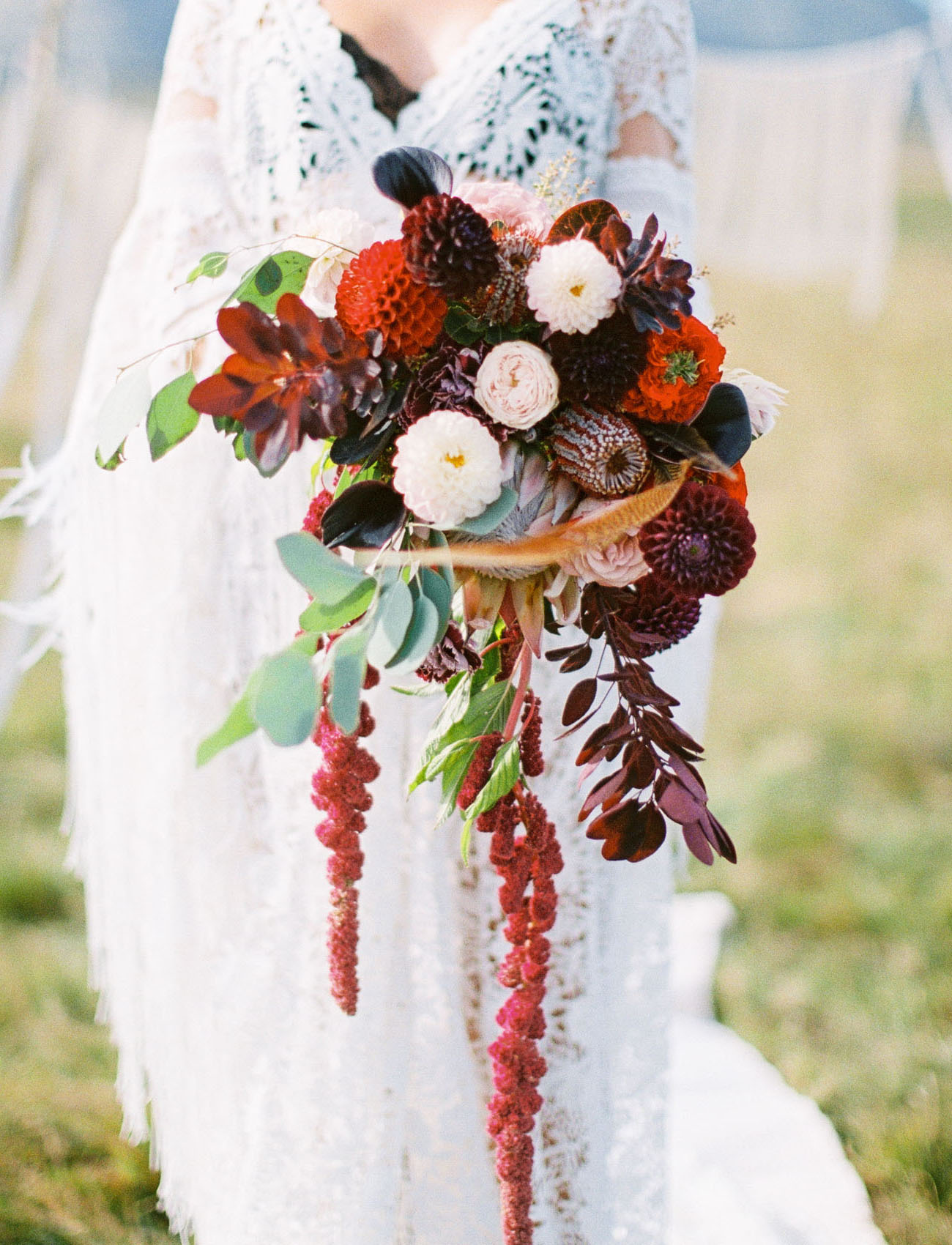 The wedding bouquet was done in sumptuous shades with cascading parts