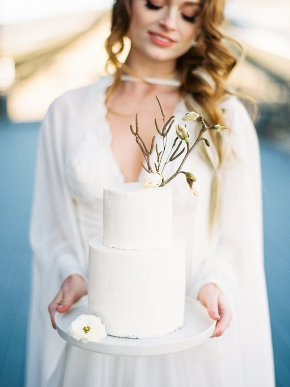 The wedding cake was a white minimalist one topped with fresh blooms