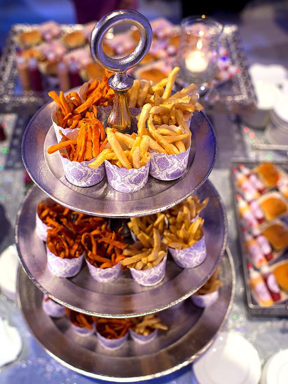 a French fry stand with fries in paper cones - add ketchup, dressings, sauces and maybe veggies