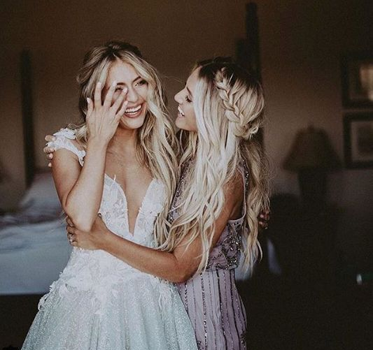 a sister bridesmaid and the bride having a moment before the wedding ceremony   you'll burst into tears