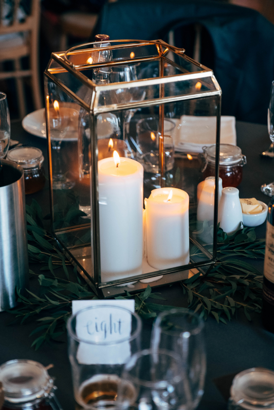 The tables were decorated with moody tablecloths, candle lanterns and lush greenery