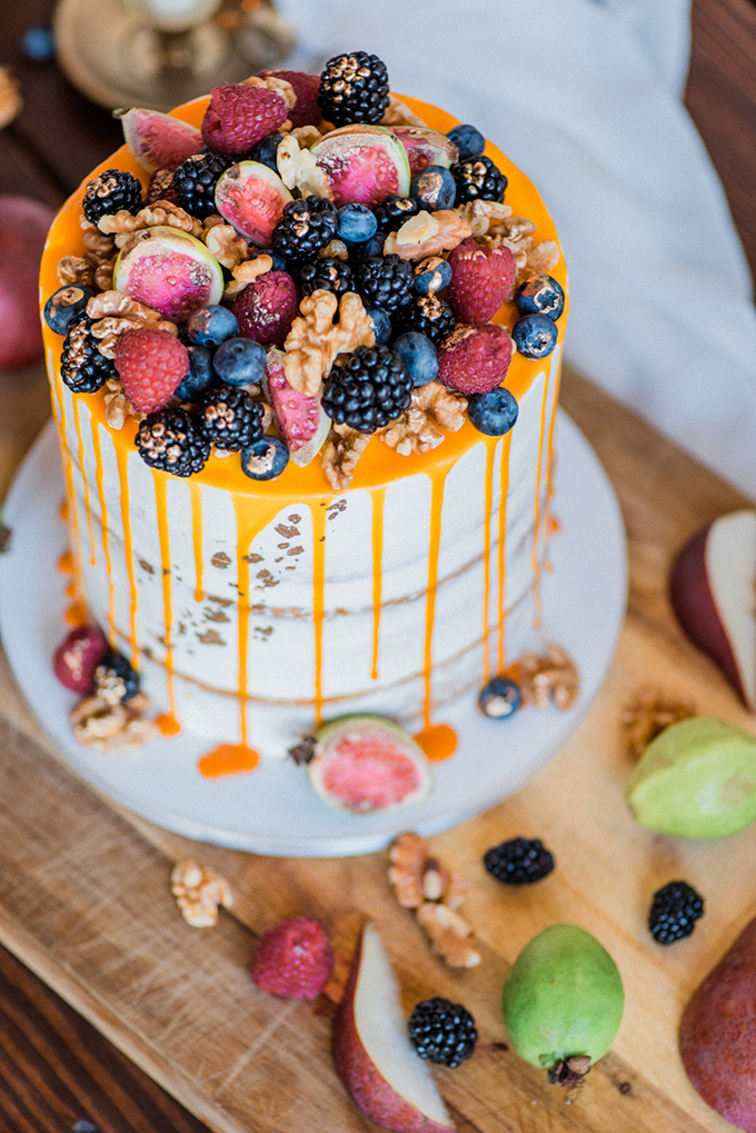 The wedding cake was a naked one with caramel dripping, fresh berries and nuts