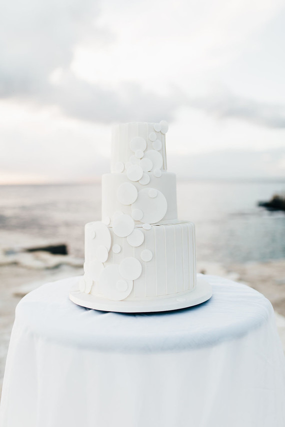 The wedding cake was done in white, with white bubble decor