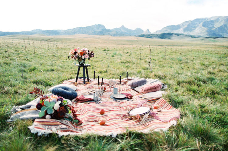 The wedding picnic took place in the field, it was all boho