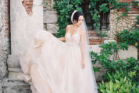 10 a blush strapless wedding ballgown with a sweetaheart neckline and a layered skirt with a train
