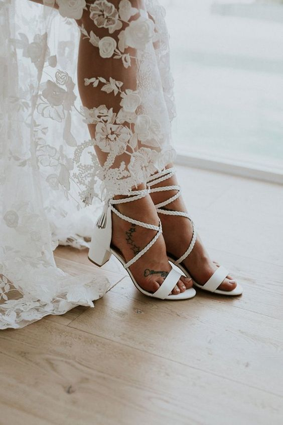 low block heel wedding sandals with braided lacing up and tassels bring a light boho feel effortlessly and in a chic way