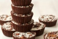 10 raw chocolate hazelnut cups with coconut on top are vegan, gluten-free and dairy-free, which is amazing
