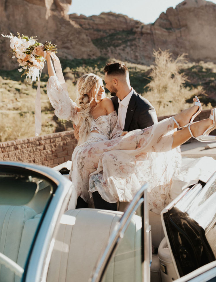 riding a retro car is a fun adventure for a couple on their wedding day