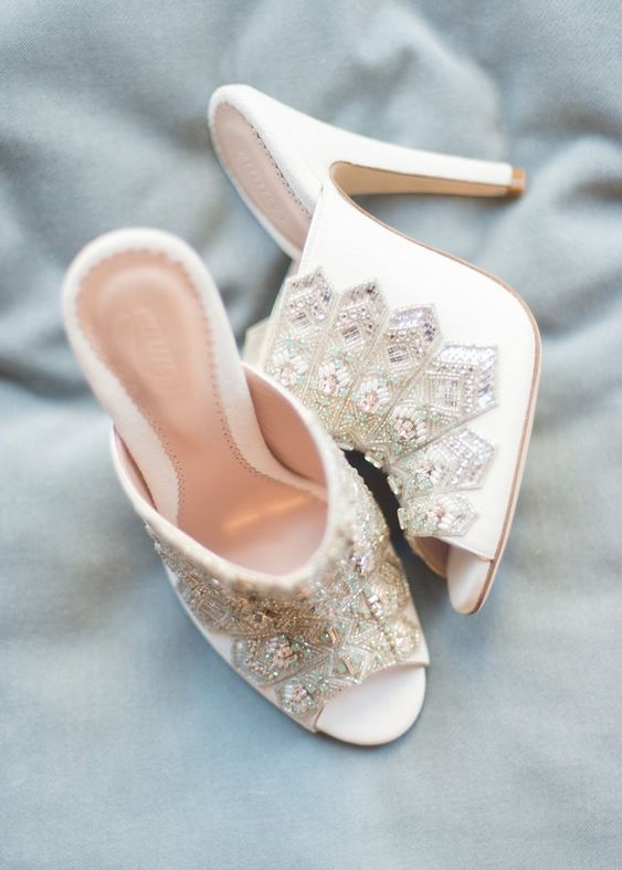 white heavily embellished mules for a fashion forward bride who wants a touch of bling
