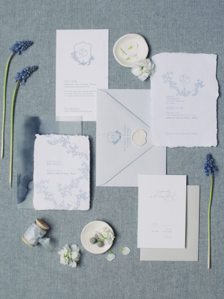 The paper goods were styled with a raw hem and blue floral patterns