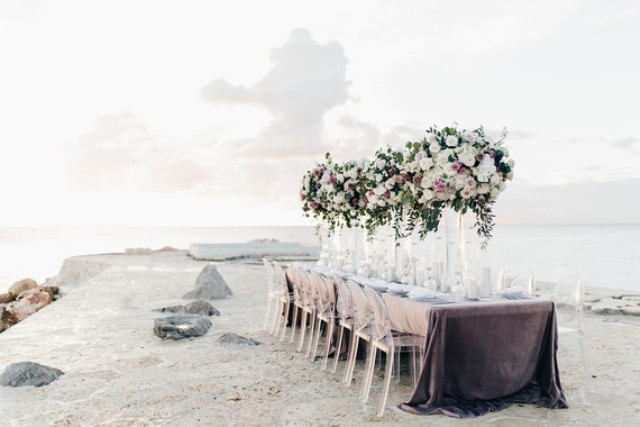 The wedding tablescape was done right on the beach