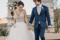 11 a beautiful wedding ballgown with a heavily embellished bodice with no sleeves and a deep V-neckline and a full skirt
