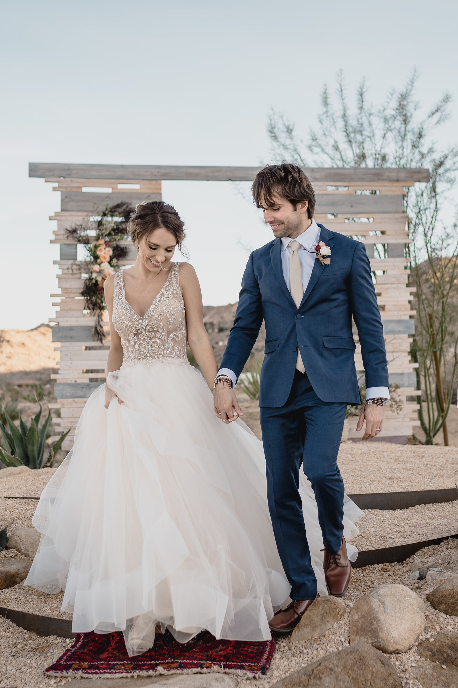 a beautiful wedding ballgown with a heavily embellished bodice with no sleeves and a deep V neckline and a full skirt