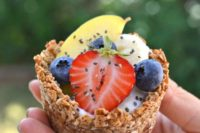 11 vegan granola cups with cinnamon, nuts, coconut oil and topped with fresh fruits and berries