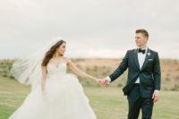a spaghetti strap wedding ballgown is a gorgeous choice for a beautiful bride