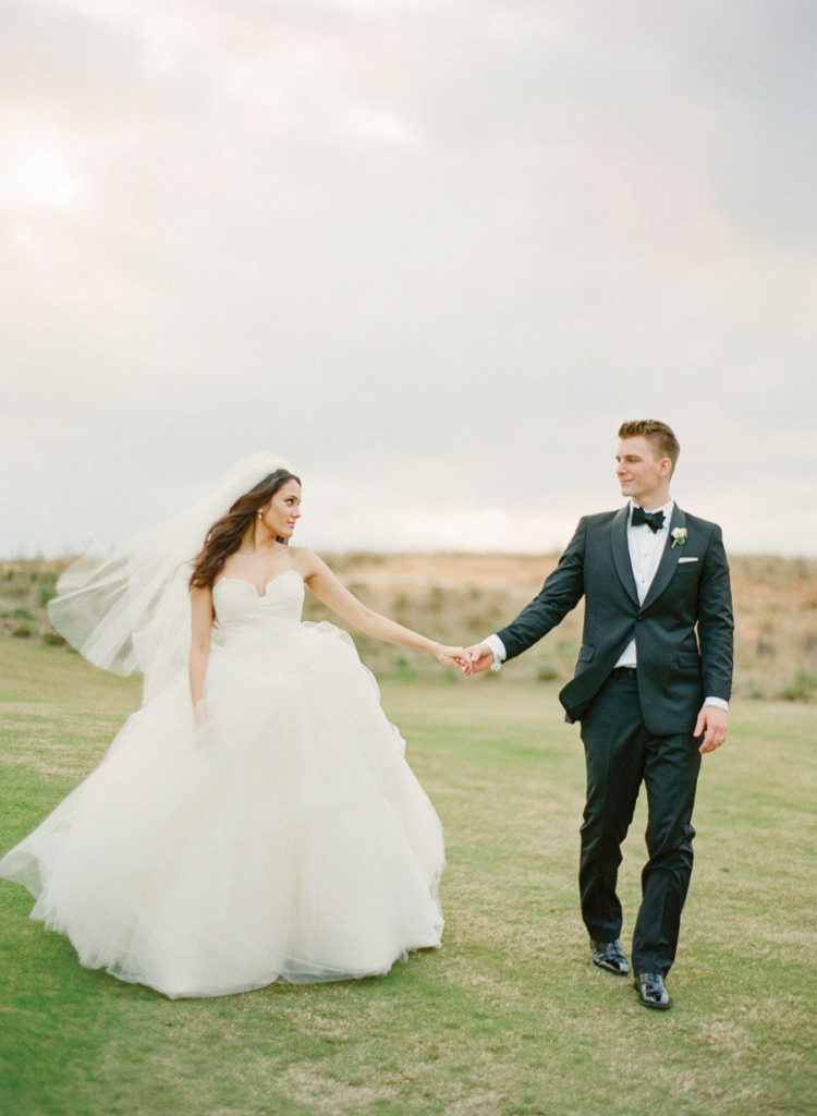 a chic spaghetti strap wedding ballgown with a whimsy cut neckline and a layered skirt