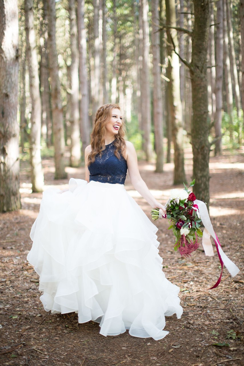 a chic wedding outfit with a navy lace halter neckline top and a ruffle full skirt
