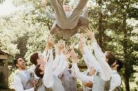 12 a groom praised by his groomsmen is a fun photo idea that will easily substitute a usual portrait with your friends