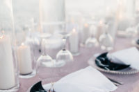 13 A blush tablecloth, pillar candles and some celestial touches were added to the tablescape