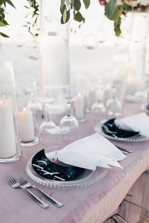 A blush tablecloth, pillar candles and some celestial touches were added to the tablescape