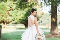 13 a chic wedding ballgown with a high neckline, a lace bodice with no sleeves and a cutout back