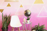 13 a colorful boho backdrop with triangles, some potted plants, a pendant lamp, a chair and globes
