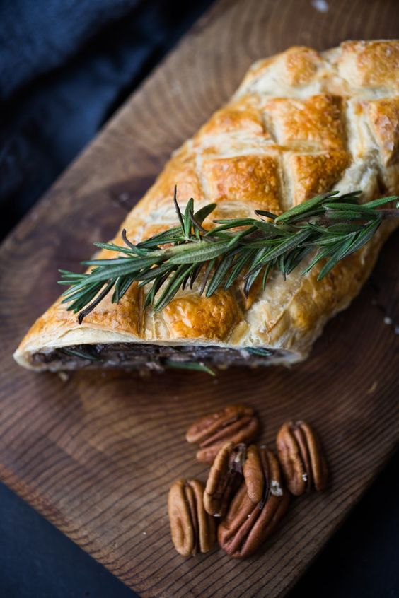 a mushroom Wellington with rosemary and pecans is a simple and tasty vegan main dish