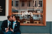 13 grooms wearing blazers, jeans, blue bow ties and different sneakers for a more unified look