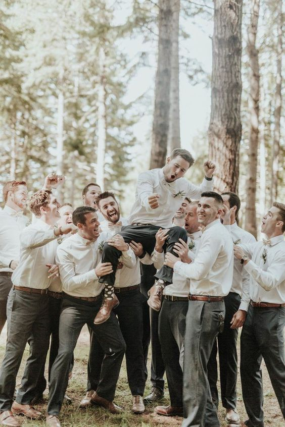 a fun groomsmen photo celebrating the wedding ceremony is a gorgeous idea instead of a traditional portrait with your friends
