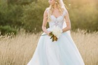 15 a light blue princess-style wedidng ballgown with a lace bodice and thick straps and a layered skirt