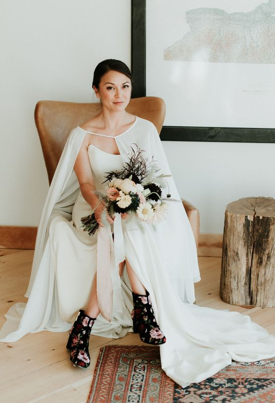 black floral wedding booties are a bold fashion statement for a fall bride, they will make your look more eye-catchy