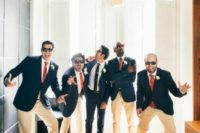 15 groomsmen having fun before the cermeony with the groom is a very cute and fun wedding pic idea