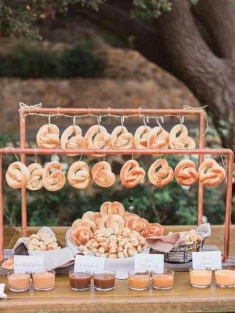 delicious fresh soft pretzels with lots of fancy condiments are a great idea to feed your guests with a twist