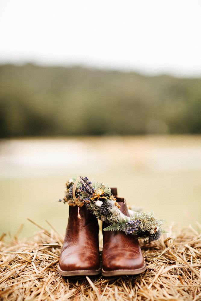 brown leather booties are ideal for a woodland or mountain boho wedding, you may walk through mud in them