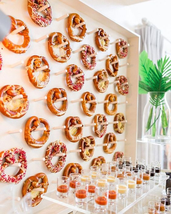 a pretzel wall with dips in glasses is a very trendy and bold idea to go for, your station will be unique