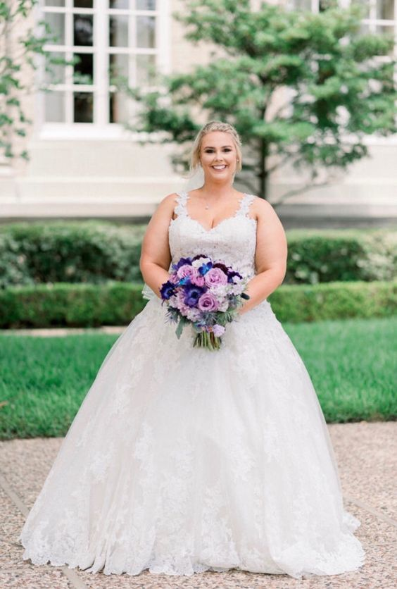 a romantic lace wedding ballgown with thick straps, a sweetheart neckline and a full skirt