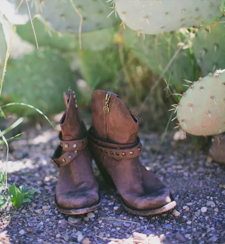 brown studded cowboy boots are a nice idea for a desert wedding to keep your feet safe