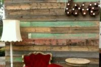 21 a shabby chic photo booth backdrop of weathered wood, a LOVE marquee, a vintage red chair and lamps