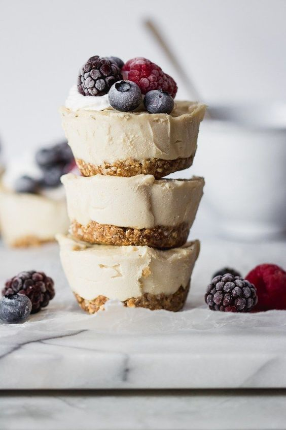 gluten free and vegan mini cheesecakes with perfectly sweet lemon flavor and topped with fresh juicy berries