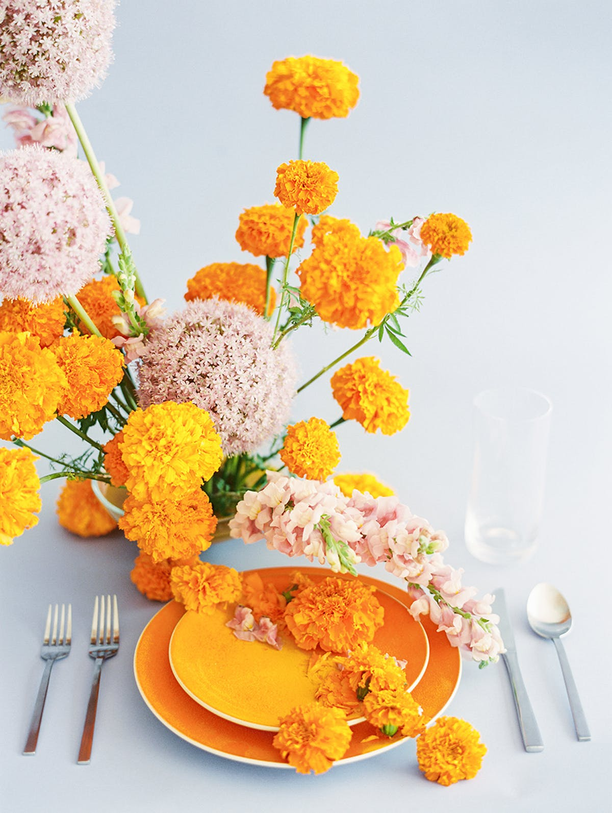 marigold and soft pink against a pale blue background is an icredible combo for a color loving couple
