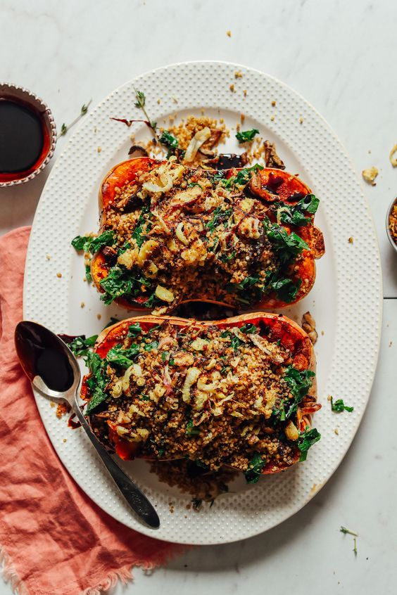 roasted stuffed butternut squash with sauteed chalot, garlic, kale, shiitake mushrooms and avocado