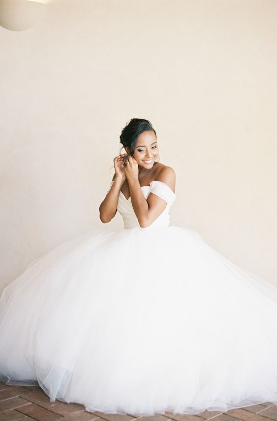 a statement off the shoulder wedding ballgown with a draped bodice and a super full skirt