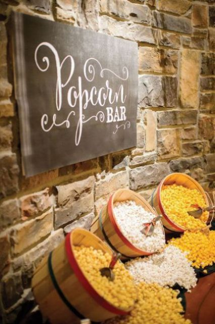 a large popcorn bar with wooden baskets and a chalkboard sign with letters